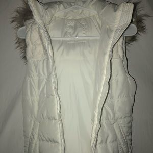 White vest with fur hood